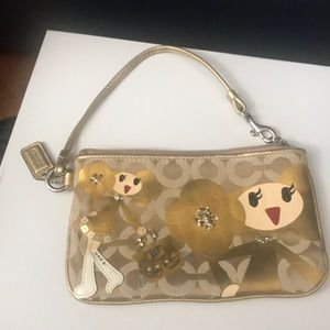 Coach limited edition goldy wristlet.